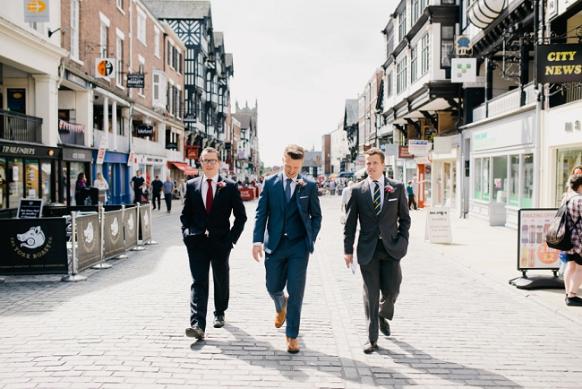 Groom walking to Chester Town Hall wedding
