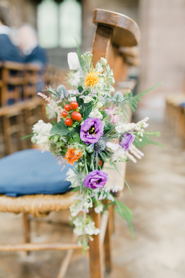 bright summer wedding flowers at church in stoke