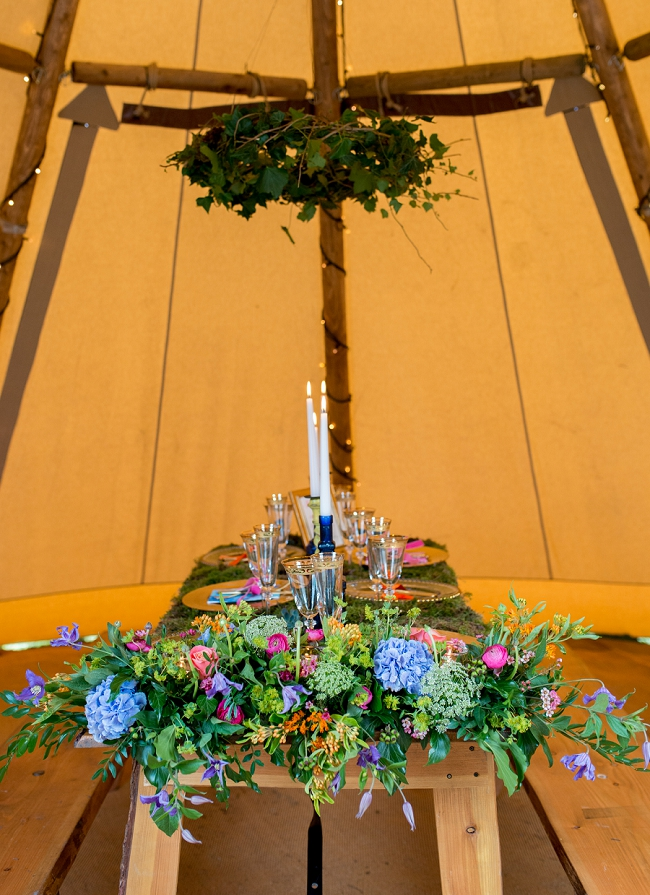 tipi wedding table with green moss