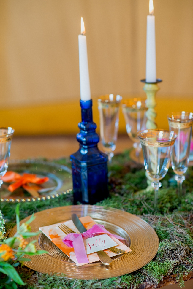 wedding table blue vases green moss