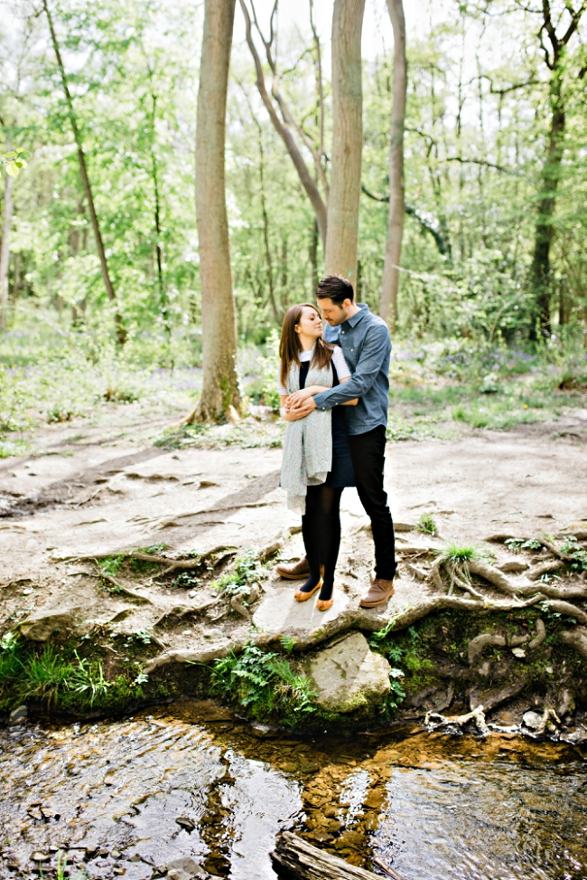 couple embracing by the river at swithland wood