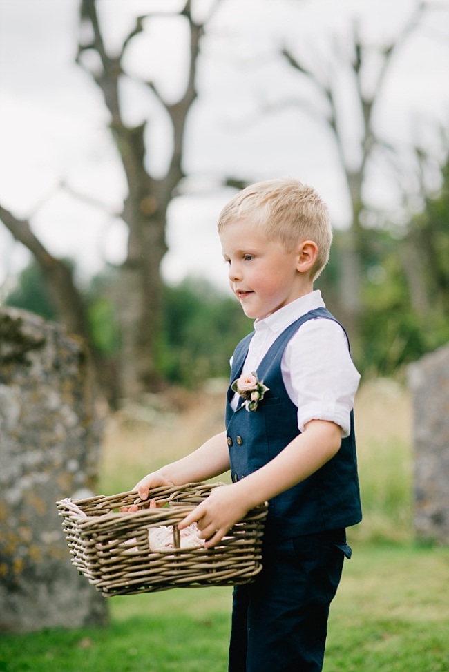 page boy with basket of confetti