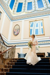 bride on staircase at shrigley hall hotel