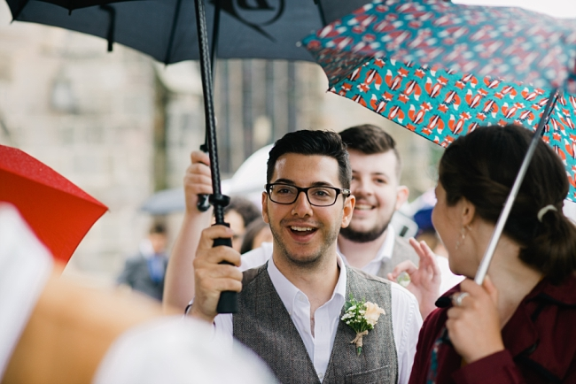 groomsman under brolly
