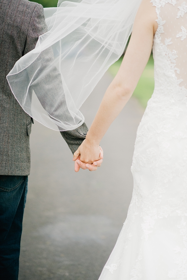holding hands with veil