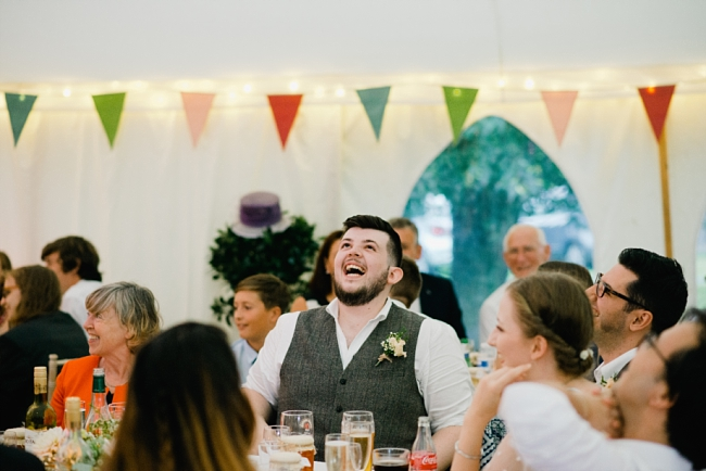 groomsman laughs at speech