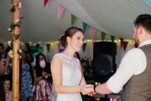 bride and groom dance to band