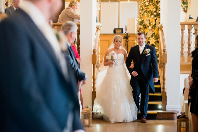 bride walks down aisle with brother