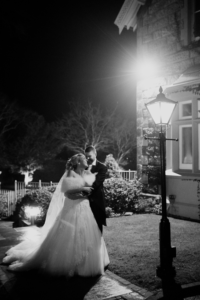 bride and groom under street light