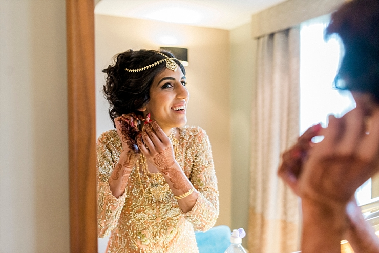 bride in mirror with earring