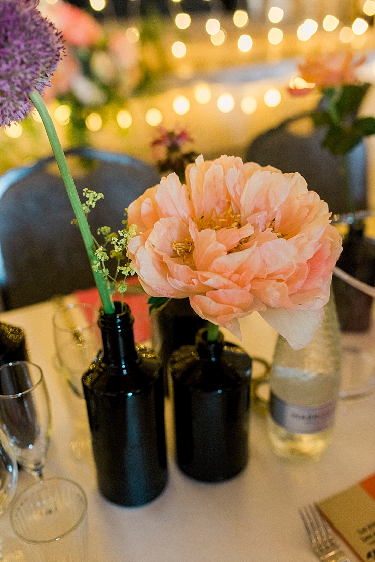 wedding flowers in brown bottles