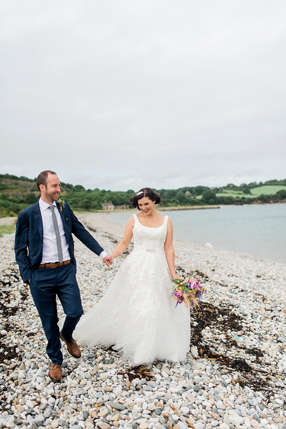 bride and groom on beach anglesey