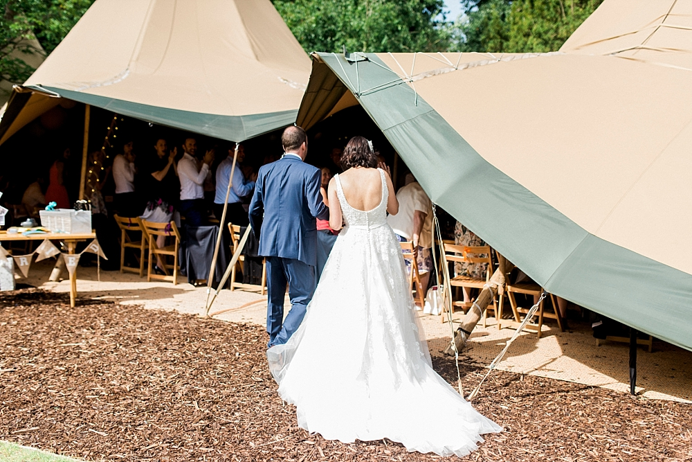 bride and groom enter tipi