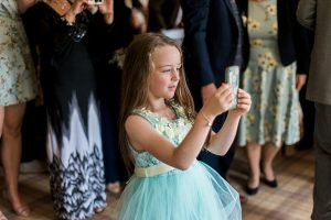little girl taking photo