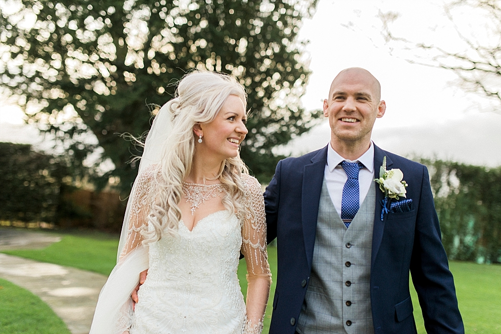 bride and groom smiling in the garden at west tower wedding venue