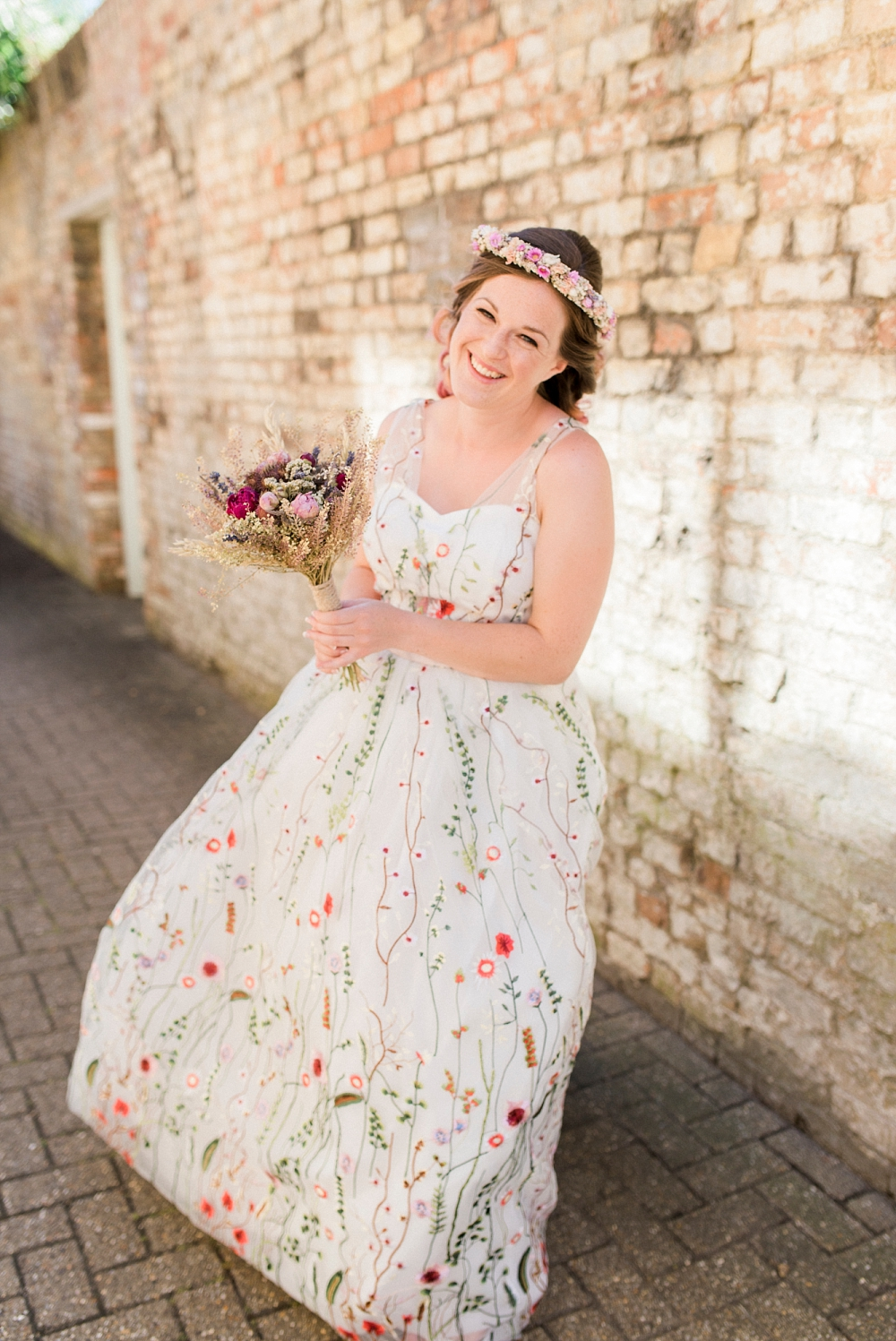 bride with floral wedding dress