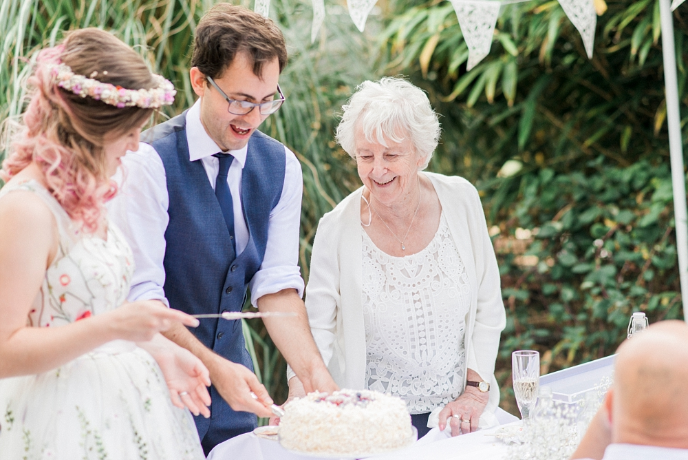 cutting the cake outdoors