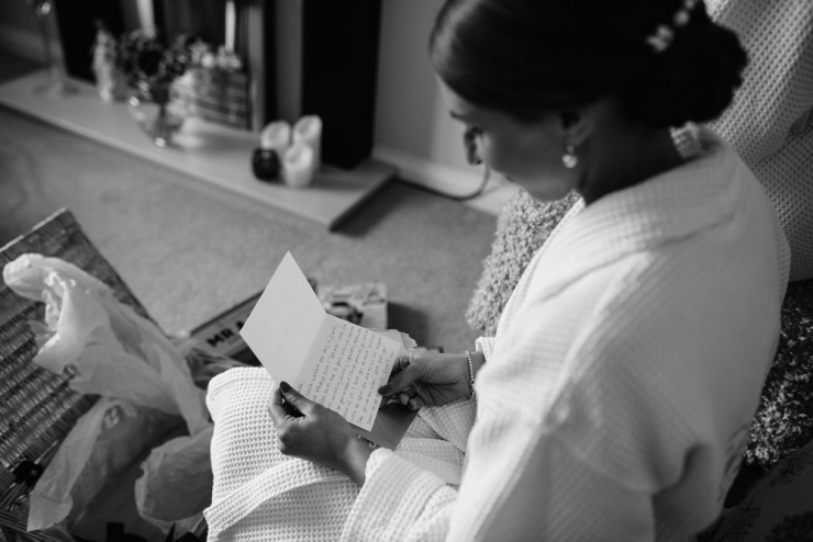 bride opens letter from groom