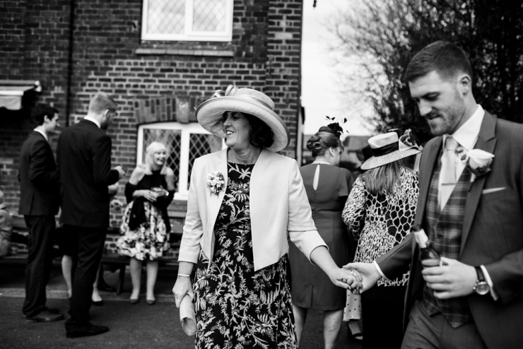 groom hold hands with mum