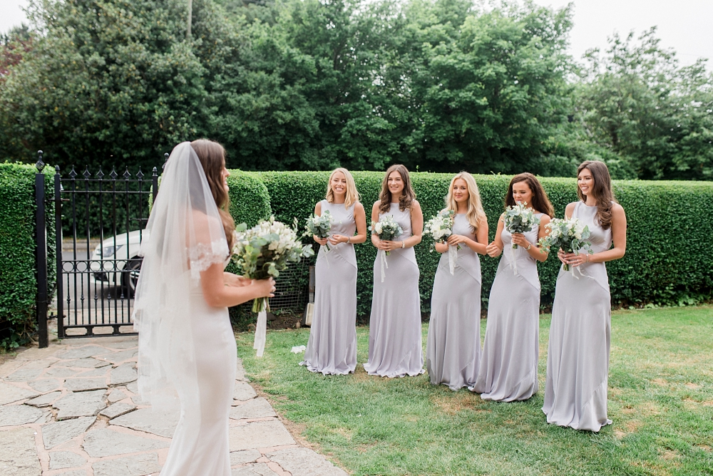 bride and bridesmaids in the garden