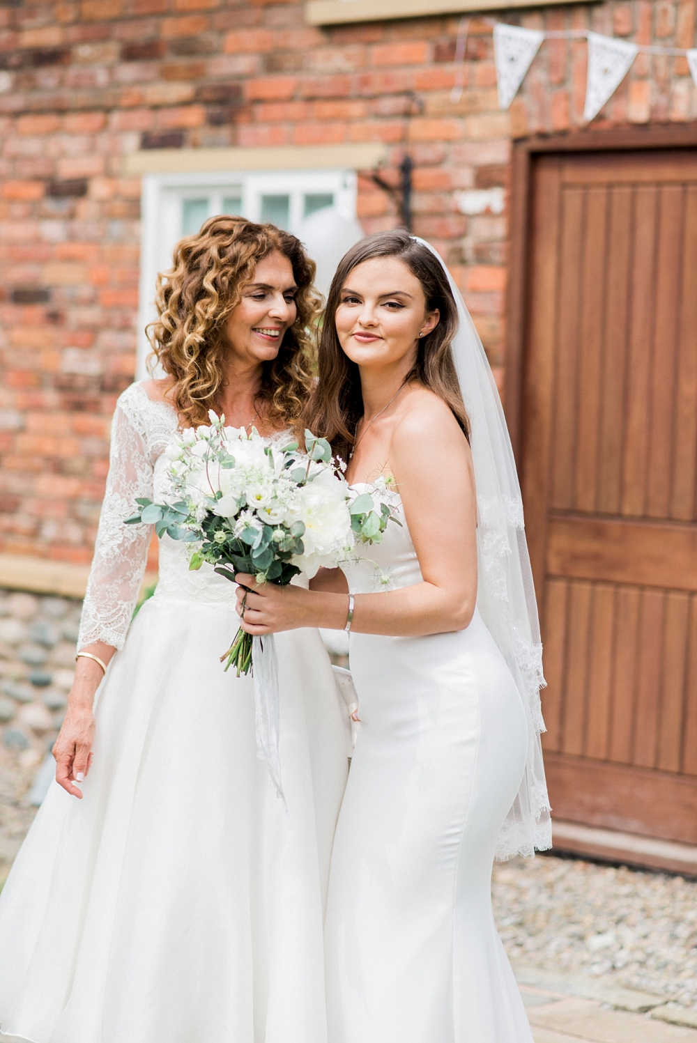 mother of the bride in an ivory lace dress