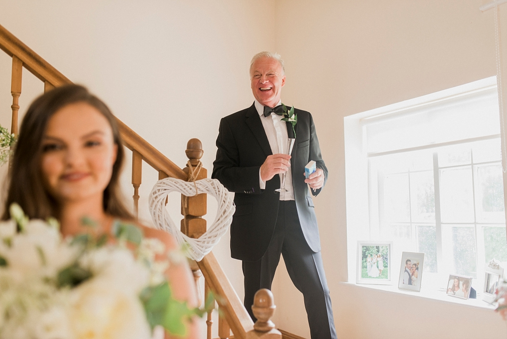 father of the bride on stairs
