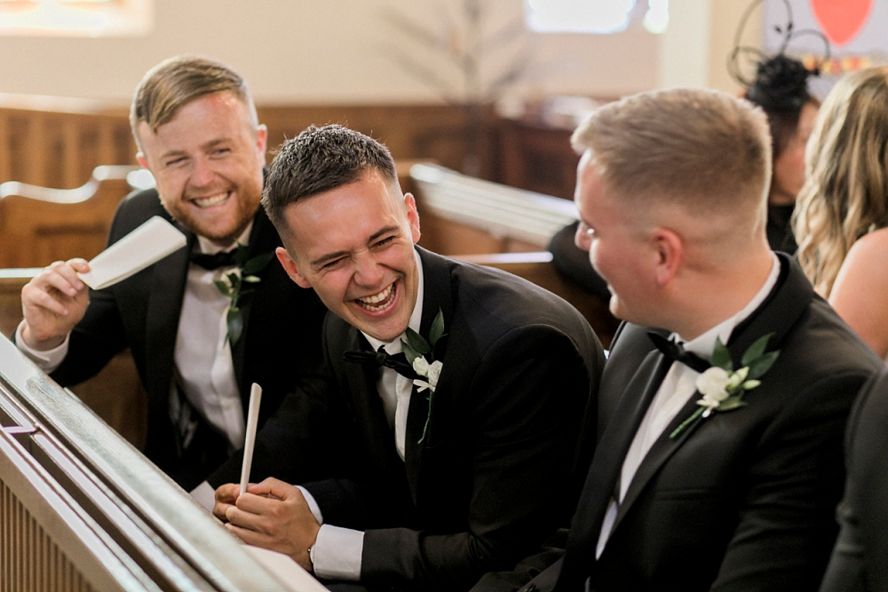 best man laughing in church