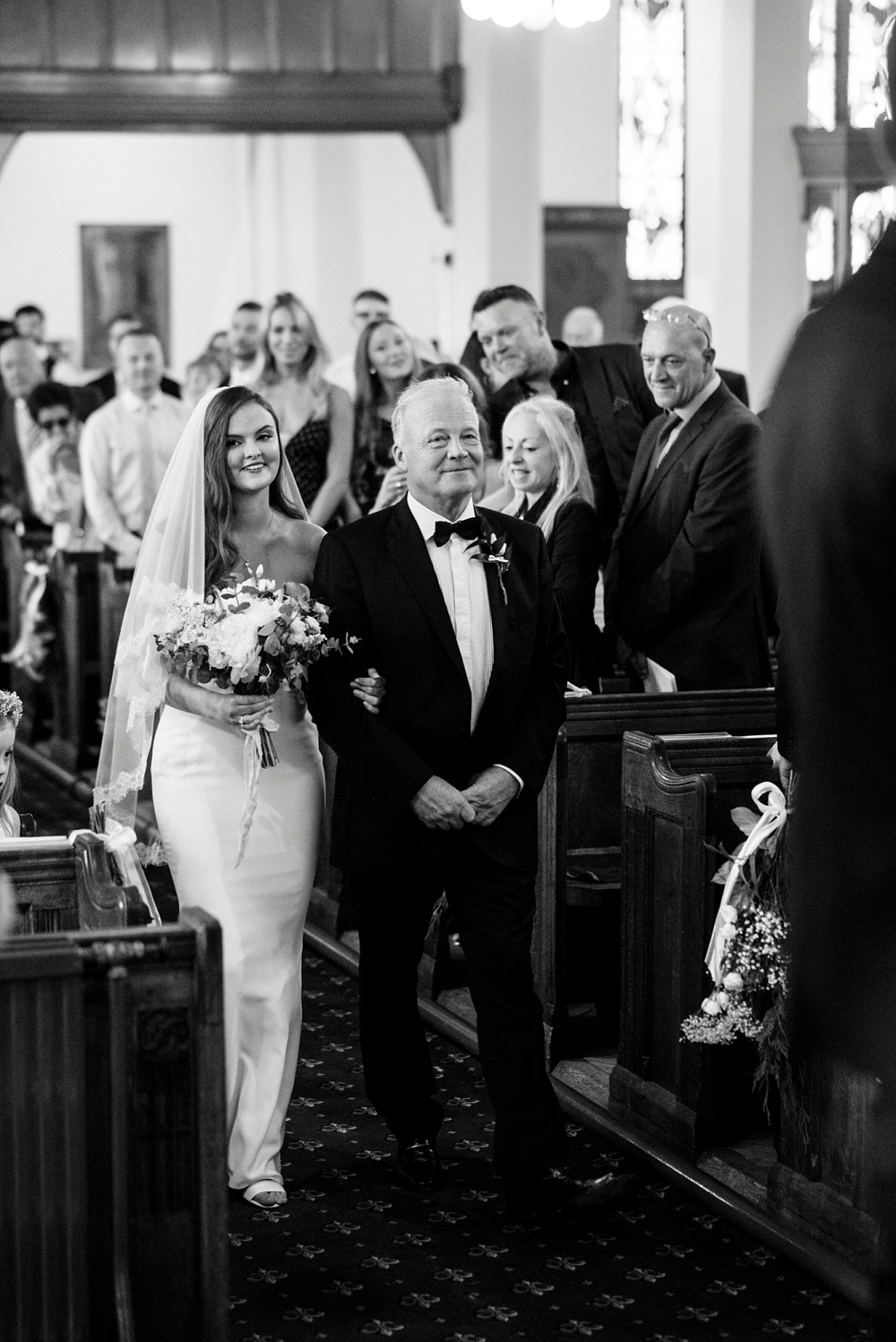 bride and her dad walk down the aisle