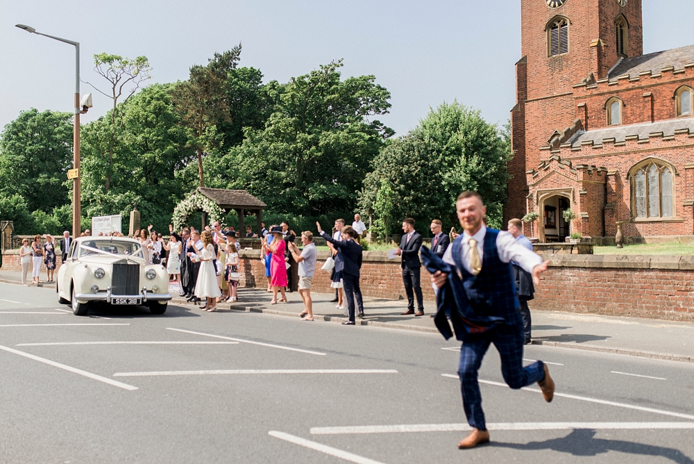 guest running across road at church wedding