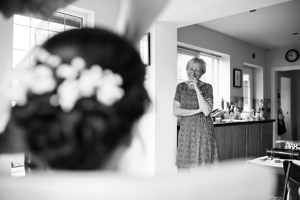 mother of bride looks on