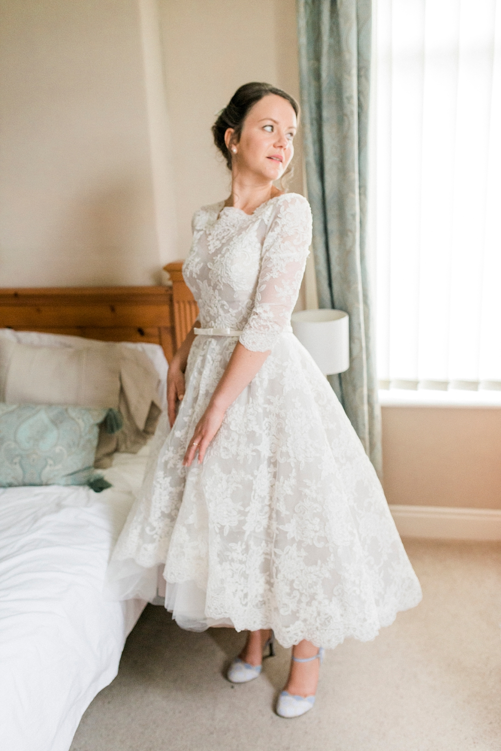 bride in tea length lace dress