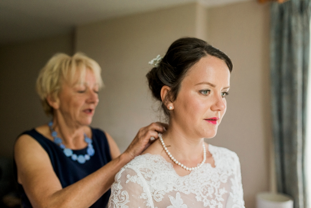 mum fastens brides pearl necklace