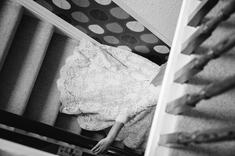 lace dress trailing down stairs