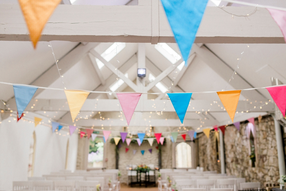 colourful bunting in wedding barn wyresdale park