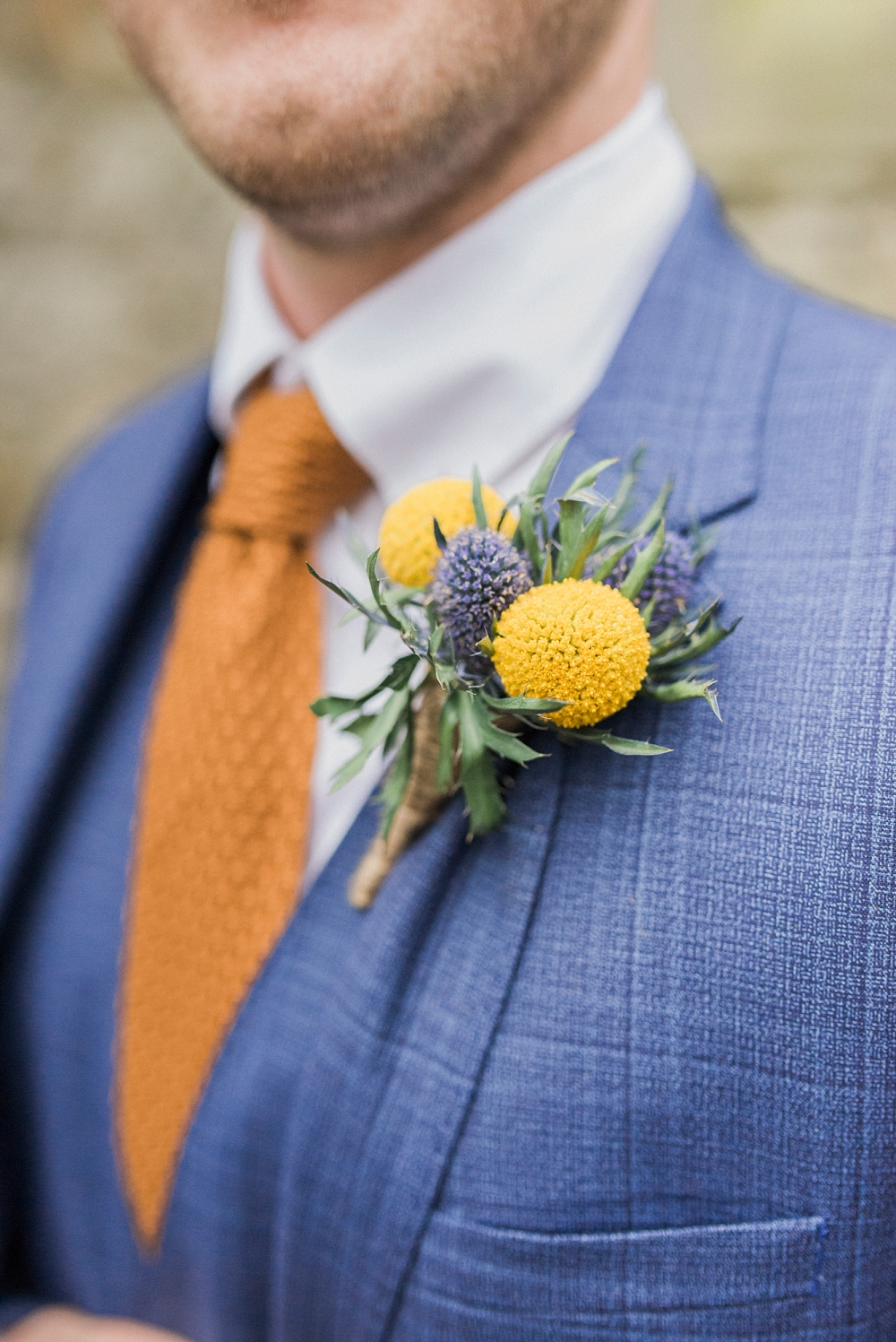 groom's yellow button hole by fylde flowers