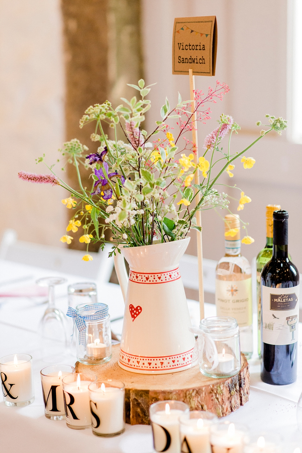 jug centrepieces at barn wedding