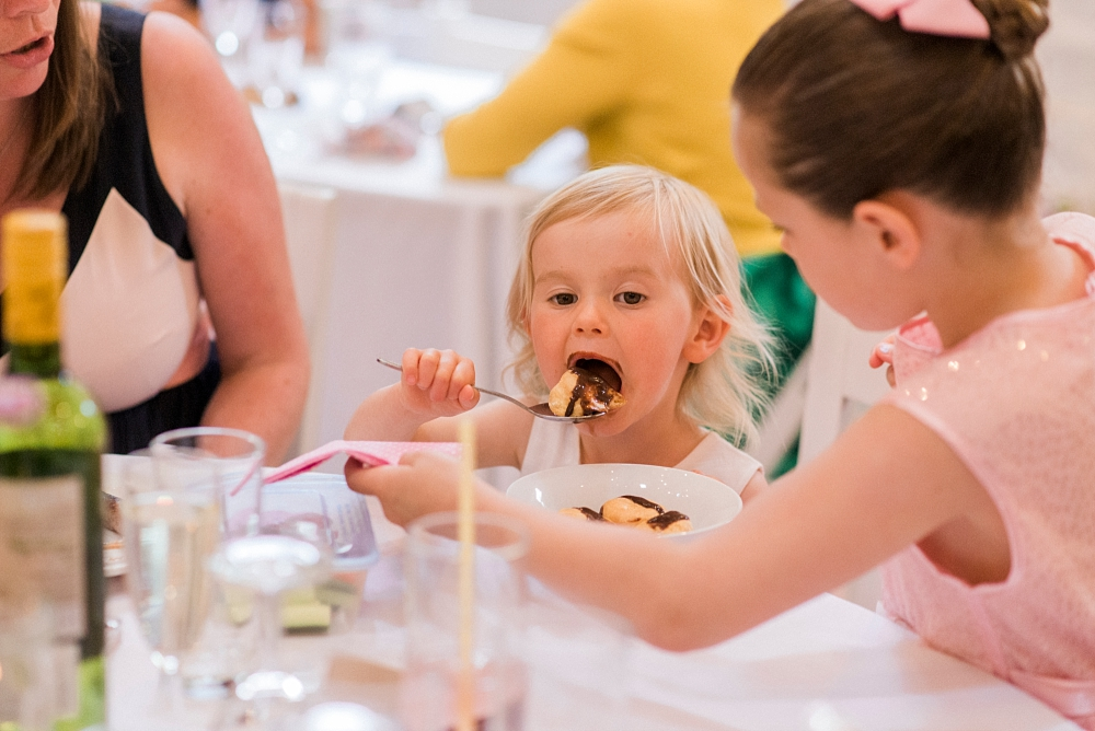flower girl eating chocolate cake