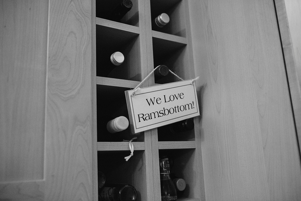 we love ramsbottom sign hanging on wine rack
