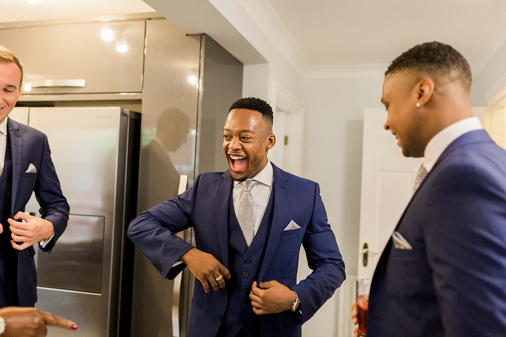 groomsman laughing in kitchen
