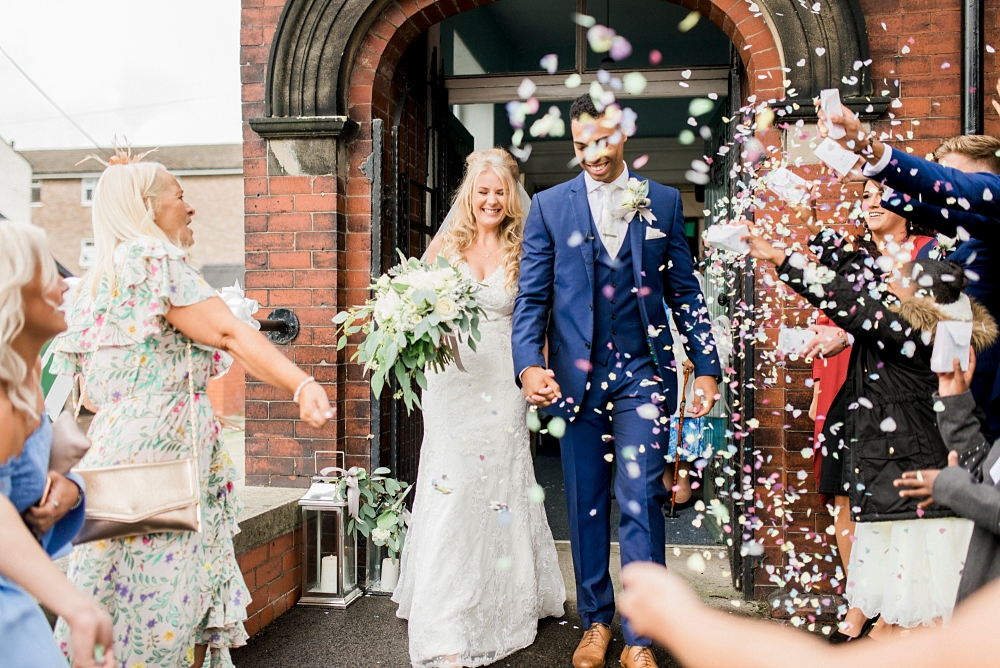 throwing confetti over bride and groom