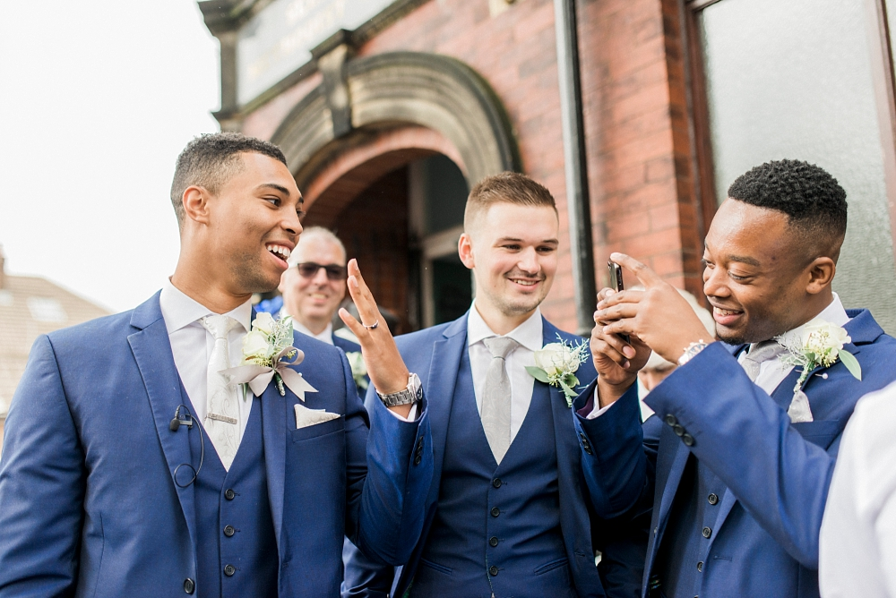 groom showing his wedding ring for photo