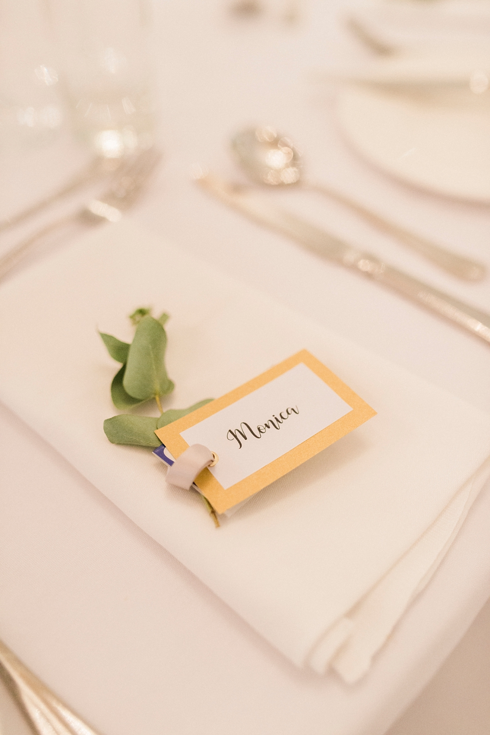 name tag place setting with foliage