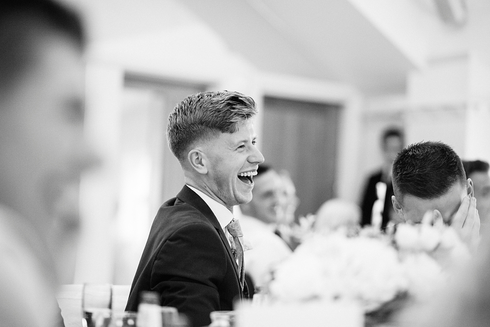 wedding guests laugh