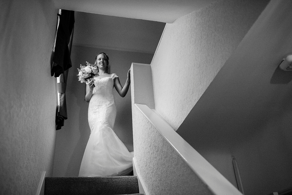 bride at the top of the stairs