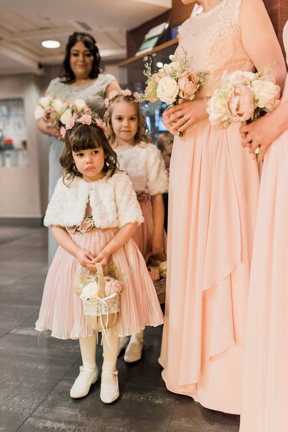 flower girls and bridesmaids in the lobby at stanley house