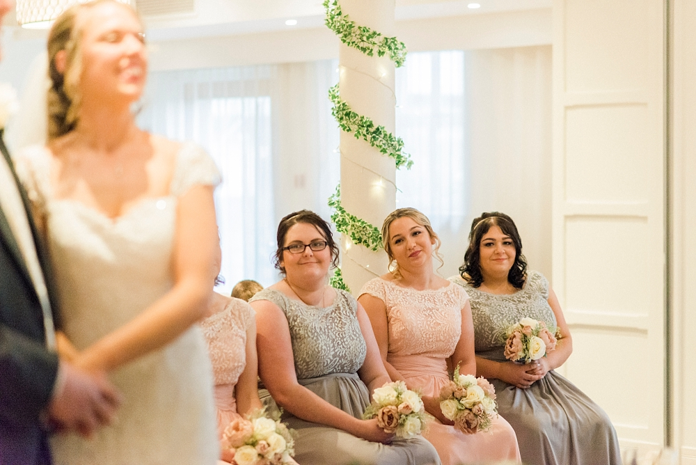 bridesmaids look on at stanley house wedding
