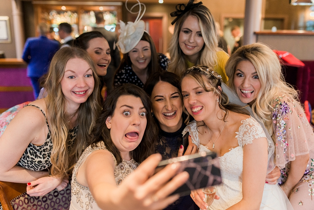 bride and friends take selfie