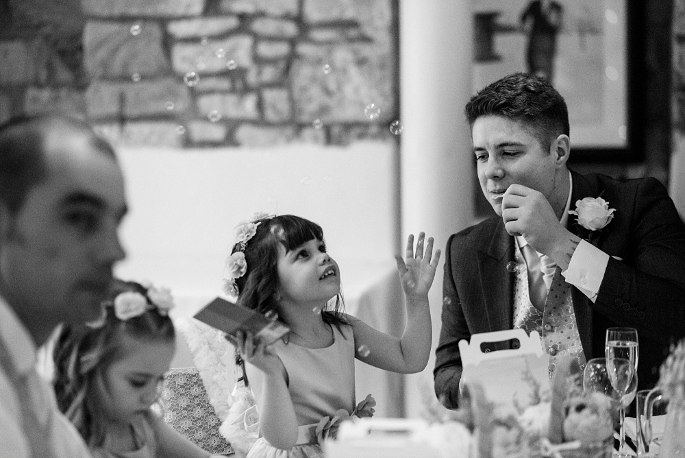 blowing bubbles for the flowergirl