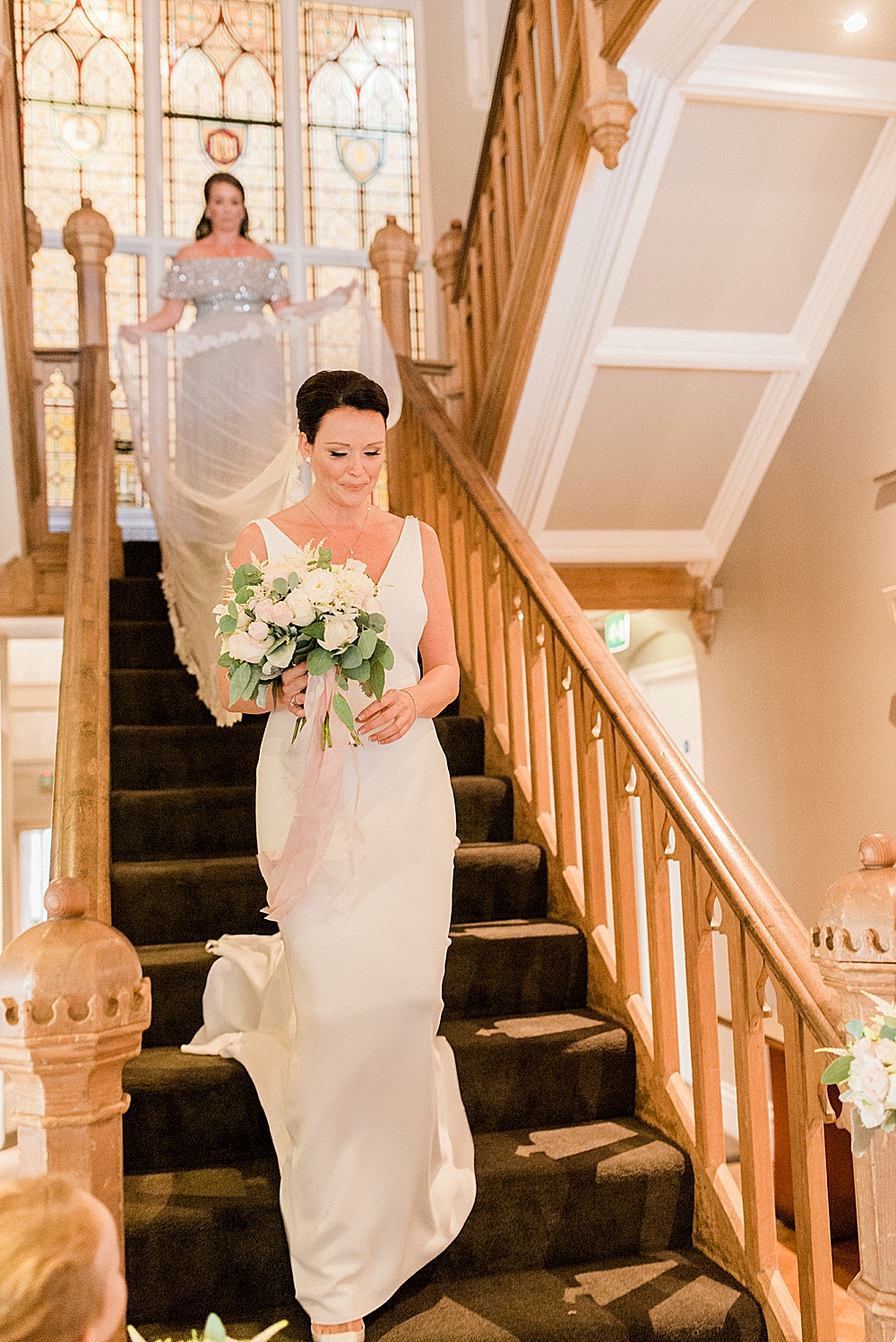 bride coming down stairs at didsbury house hotel