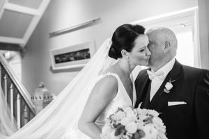 bride gets kiss from dad